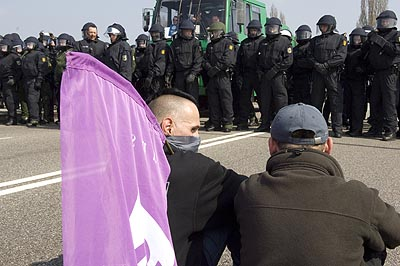 Lots of German riot cops erect their own border.
