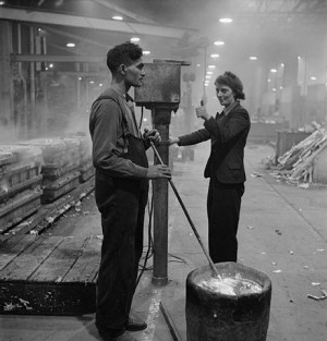 Let's Talk About Class - Mr Hamid, from India, discharged from the British army on medical grounds, inserts a thermocouple into molten metal, waiting for the thumbs-up signal from his colleague, as she lets him know that the correct temperature has been reached. They are working on a Merlin engine at a Rolls Royce aircraft engine factory in 1942 - via Wikimedia Commons