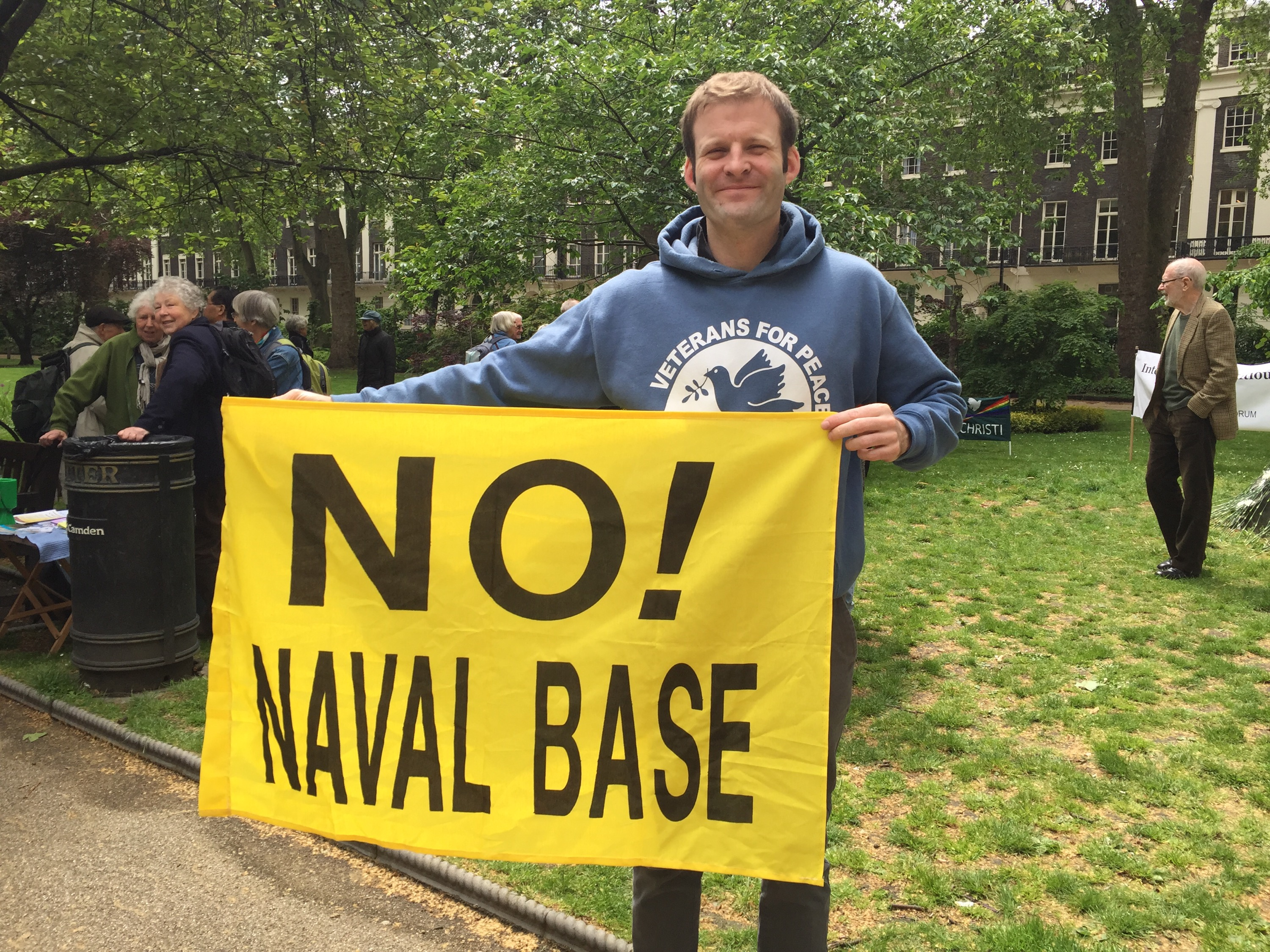 Ben Griffin, ex-SAS officer and founder of Veterans for Peace UK, holding No Naval Base flag
