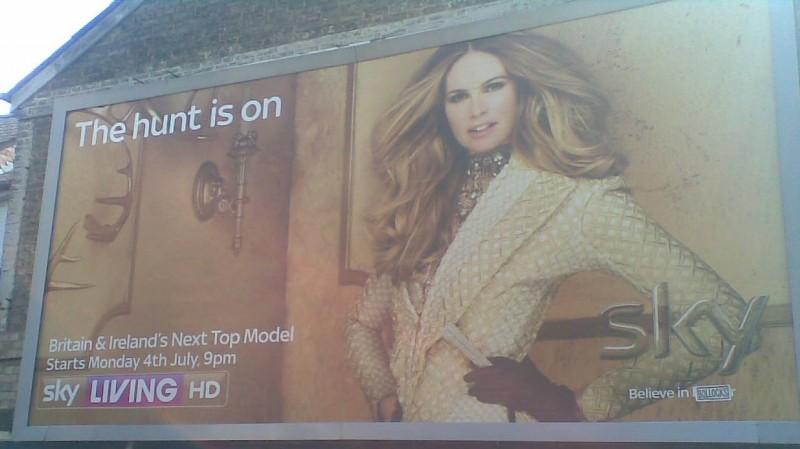 "Billboard ad for Sky with added ""Bollocks"" sticker"