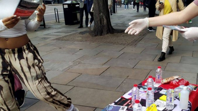 Handing out leaflets
