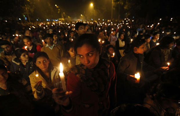 Indians light candles as they mourn the death of a gang rape victim in New Delhi, India , Saturday, Dec. 29, 2012. Indian police charged six men with murder on Saturday, adding to accusations that they beat and gang-raped the woman on a New Delhi bus nearly two weeks ago in a case that shocked the country. The murder charges were laid after the woman died earlier Saturday in a Singapore hospital where she has been flown for treatment. (AP Photo/ Saurabh Das) ORG XMIT: DEL147
