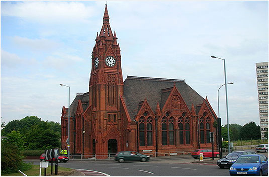 Spring Hill Library is a red brick and terracotta Victorian building in Ladywood, Birmingham, England. Designed in 1891 by Martin & Chamberlain with a 65 foot (20 metres) clock tower on the corner of Icknield Street and Spring Hill and opened on January 7 1893