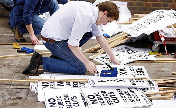 man making placards
