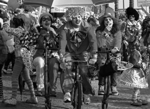 Carnival revellers dressed as clowns pedal on the clowns parade in Sesimbra village February 11, 2013.  REUTERS/Jose Manuel Ribeiro (PORTUGAL - Tags: SOCIETY) - RTR3DNM6