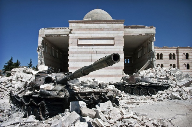 Two tanks in front of a mosque in Azaz, Syria, following a battle between the Free Syrian Army (FSA) and the Syrian governmen